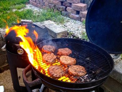 hamburgers on fire